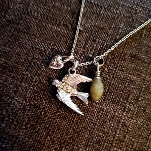 Fossil swallow necklace